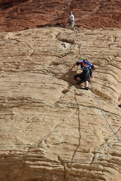My 12yo daughter finishing first pitch.  Second pitch continues straight over/above my head.  Great two pitch sport route 5.7 in Red Rocks, Nevada