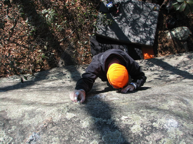 Orange Man crystal pinching up the steep slab