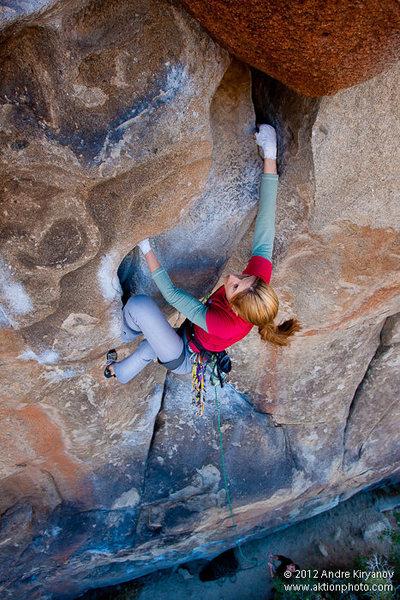 "Leah Sandvoss sending ""Leave it to Beaver"", 5.12a, Joshua Tree National Park, CA. Photo by Andre Kiryanov"