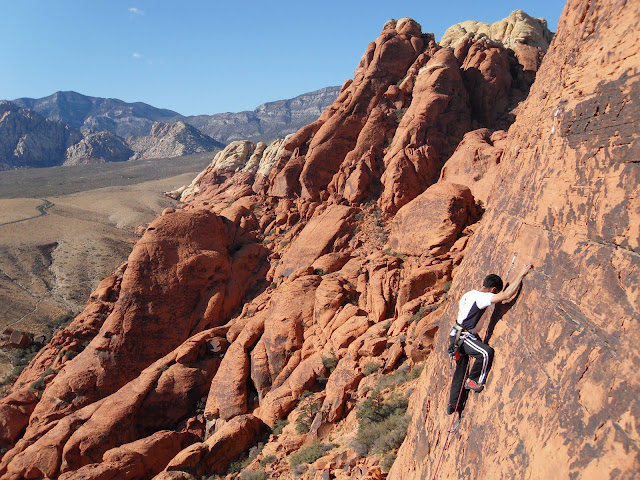 My friend Raj on the route - it is nice and airy for a 5.8 and one of the best views you can have doing sport in Red Rocks