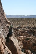 Rock Climbing Photo: Smiling Albert Ramirez passing the roof.