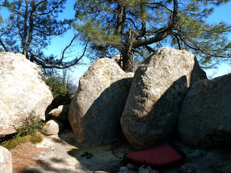 Courtyard Face follows the rightward trending arete on the right boulder.