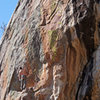 Standing on the small ledge.  The next set of bouldery moves is the crux, but the holds are big...