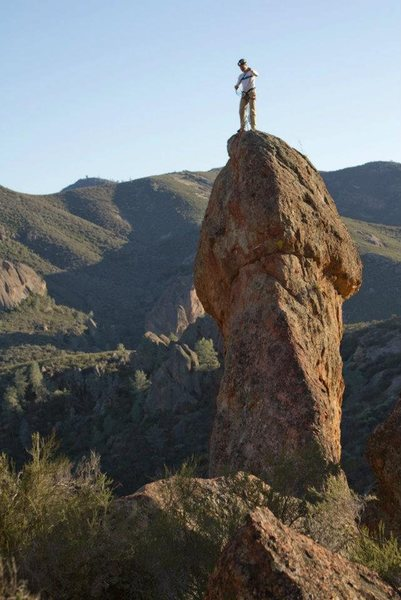 Photo of a climber on top.