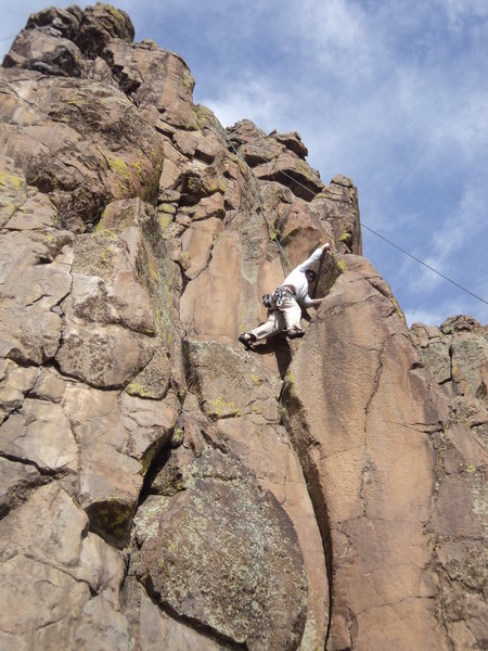 Mark Hudson making the fun reach for the arete hold.