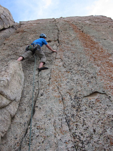 Rock Climbing Photo: Joe steps off the pillar into the seam on the firs...