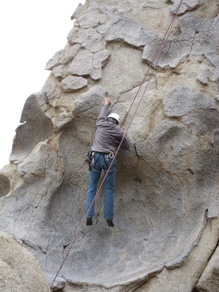 Richard Alden, hanging the pre-crux move above the dish on Pancakes and Cornflakes.