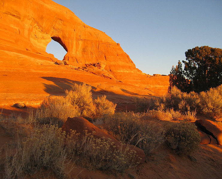 Looking Glass Rock Arch sunset.<br> <br> Photo: Ryan Ray