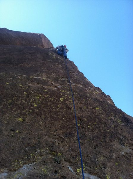 Pitch 4. Chris passing the bolt at about 25' up.  Then it's another run to a FP under the boulder.