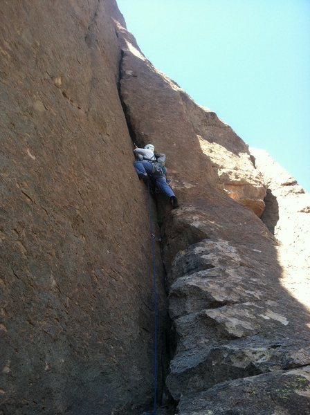 """Chris getting into the crux on P2.  No big gear needed.  Up to 2"""" protects it well."""