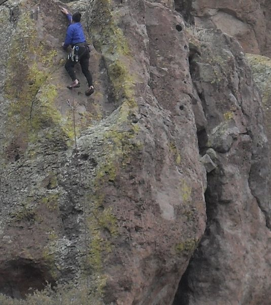 Rock Climbing Photo: Karl tops out in gale force winds.