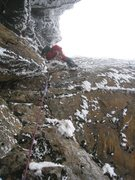 "What would the crux on gully #2 have been looked like in not-so-good seasons. Dr Fangyuan Chang dry-tooling the ice-less steep rock terrain at the very same position as the 2 ""white"" 2005 photos on 2008 Valentine's day.  Photo kindly provided by Hsiaomo Chen, aka ""k2mo"" or ""Laughing devil"""