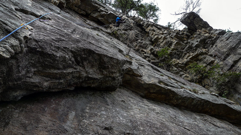 """Pawel in the awkward bit of the traverse, all 6'7"""" of him"""