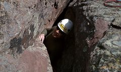 Rock Climbing Photo: Crawling out of the cave on the 2nd pitch of the 4...