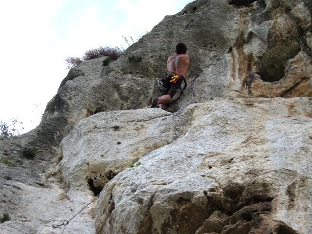 Heading to the hanging anchor on real steep rock on Le Valchirie