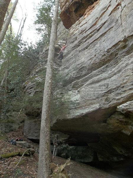 Rock Climbing Photo: Climbing  out the crack, roof seen near belayer