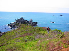 Jamie on the approach to the twin coves climbing area. The boulder containing Blue Heron can be seen to the right.
