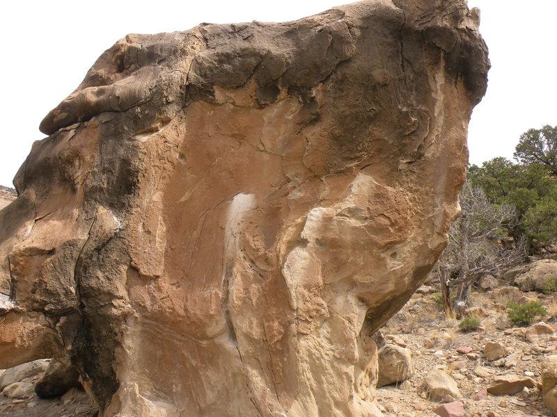 Tim's Rash is on the slab part of the boulder