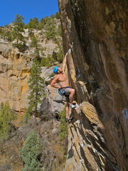 """Unidentified Durango rope-soloist gets his Ape on. Follow the """"Simians"""" crack about 20 feet, cut left to a ledge over some easy runout face climbing, begin """"Apes"""" here (bolt line immediately left of the Watch Crystal Crack)."""
