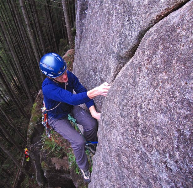 Eric Hirst getting established over the roof on Baby Tapir (5.11a).