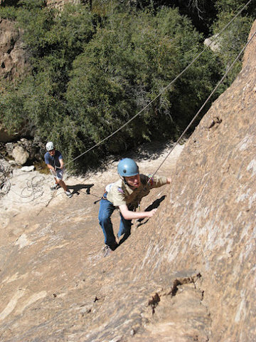 Caleb belaying Steven(Colton's son w/ Autism), as he makes his way to the top and to his Eagle Scout!
