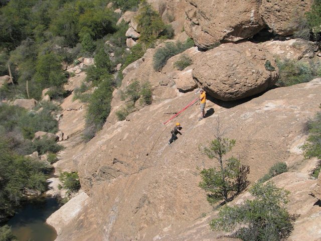 Aaron watches from the top as Jonathan makes his way up