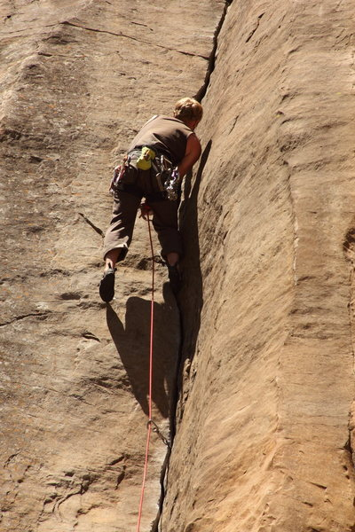Visiting climber pulling through main crux on an onsight attempt of Paradise Lost