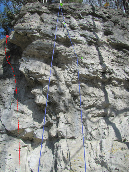 The red route on the left is Das erste Mal, and the route with the green Xs and rope hanging from it is Lampenfuzzi.