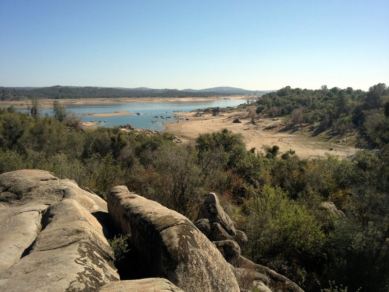 Late winter water levels at Folsom Lake, with a few tantalizing granite boulders showing here and there.