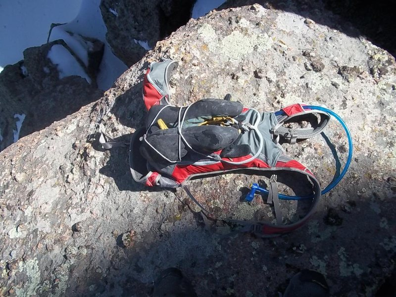 Climbing shoes attached to running pack.