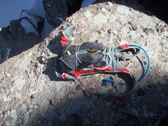 Rock Climbing Photo: Climbing shoes attached to running pack.