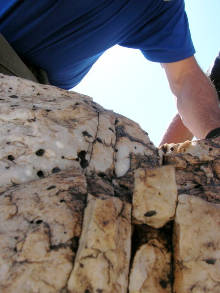 Yep, we grabbed on to this precariously wedged chip on top of the Severity Buttress.... and it held