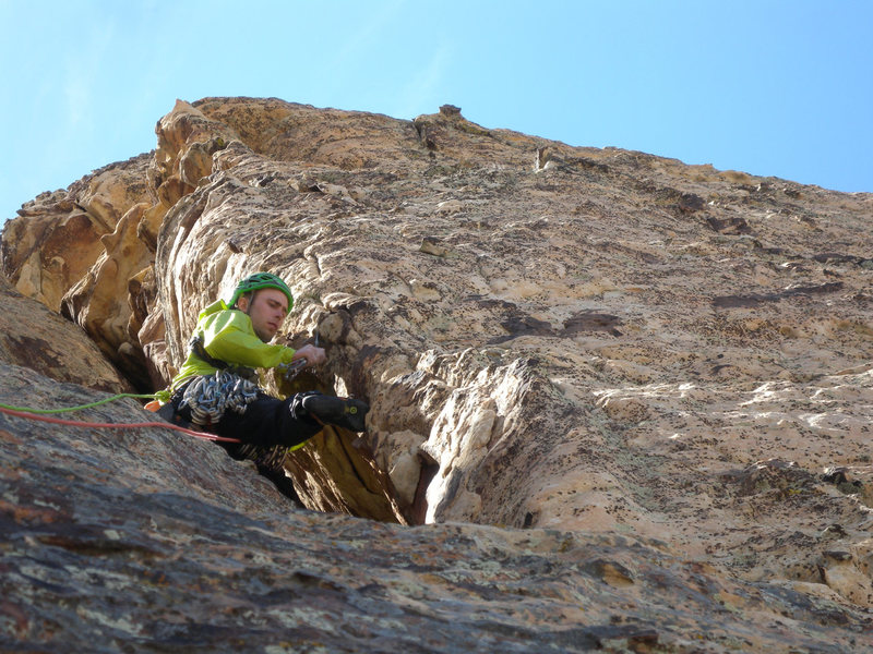 Blake fiddling with gear before the chimney on pitch five.