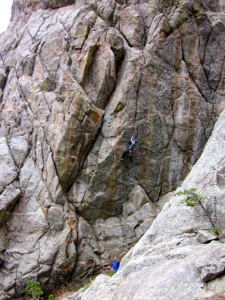 Chris Sheridan climbs Mile High Comic Crack - Nighthawk climbs the wide crack / corner to the left.