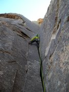 Rock Climbing Photo: Blake eyes the crux finger crack up and left from ...