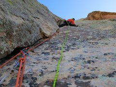 Rock Climbing Photo: Chris leading the third pitch up thin double crack...