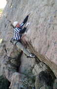 Rock Climbing Photo: Erik Wolfe hitting the crux hold on the FA