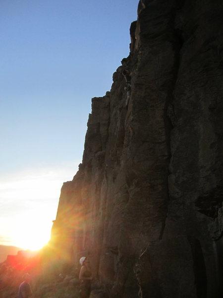 Ethan Henderson belayed by Mackenzie Carpenter climbing Coyote Crack