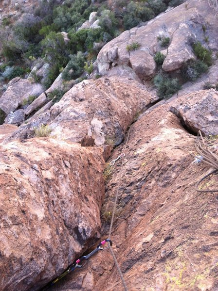 Looking down at P1 from the belay ramp.