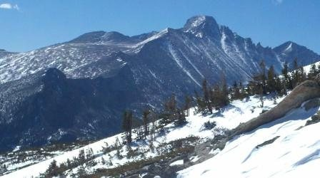 Made turns in sweet corn today on east bowl of Flattop. Tons of snow still above Emerald lake. Pic of Long's....