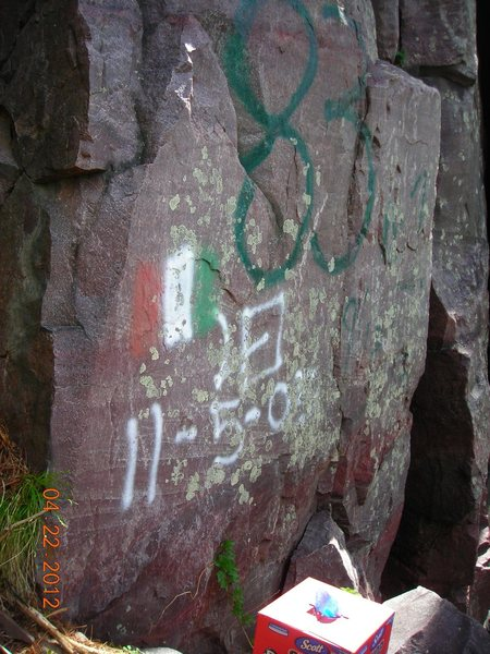 "Offensive graffito on far left side of the ""Hole In The Wall"" formation on the East Bluff not far from Balanced Rock Wall."
