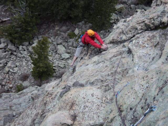 Dave enjoys the easier climbing above the start of P1.<br> <br> This pitch is probably 90 feet long.  Also, an 80 foot rappel gets you to the ground from the P1 anchor.