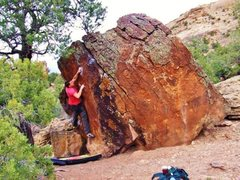 Rock Climbing Photo: Arien setting up for the dyno to the jug.