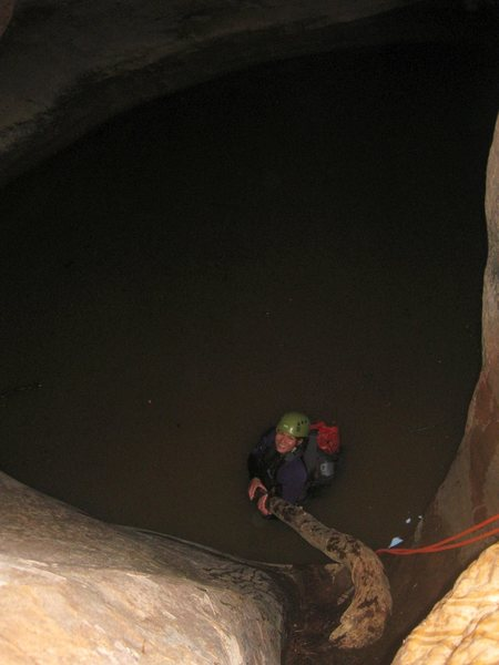 Jen on her very first canyoneering route. She was smiling, and laughing the whole time, even when I had her rap into nasty, ice cold water, and do a beached whale move out of the keeper pothole- what a good sport! <br> <br> Zion-2011