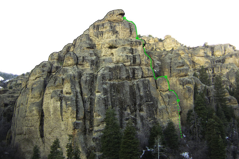Dizzy Rock as viewed from the Schoolroom parking area. <em>The Dizzy Channel</em> starts out of sight at the base of the arete.