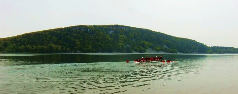 Devils Lake Regatta 4/28/12<br> Badgers row to the start.