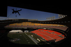 Hanging ad banners at RFK Stadium