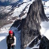 Rob rappeling, Snow Patch Spire in background