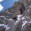 Nate Erickson leading above the chimney. On April 29, 2012, there was barely any ice on the route.