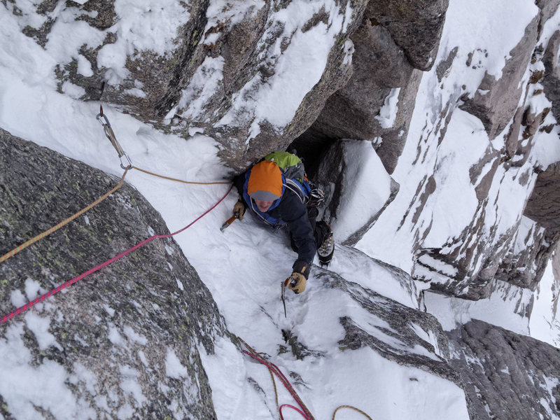 Scratching for pick holds above the crux. Nate Erickson. April, 2012.